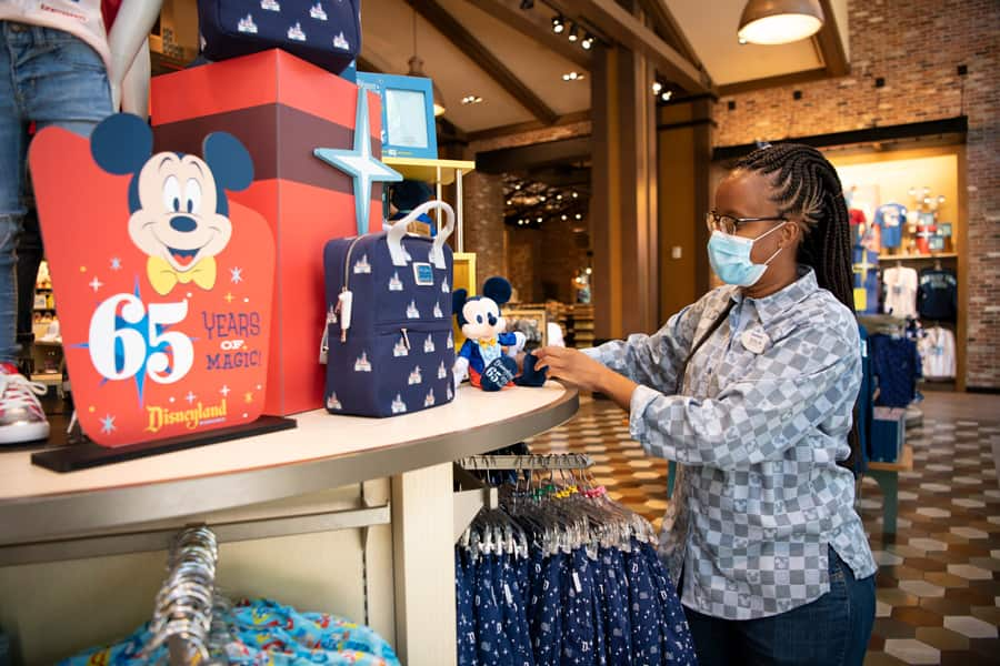 Welcome Back to Downtown Disney District, Phased Reopening Begins Today at Disneyland Resort Cast member in World of Disney store in the Downtown Disney District at Disneyland Resort