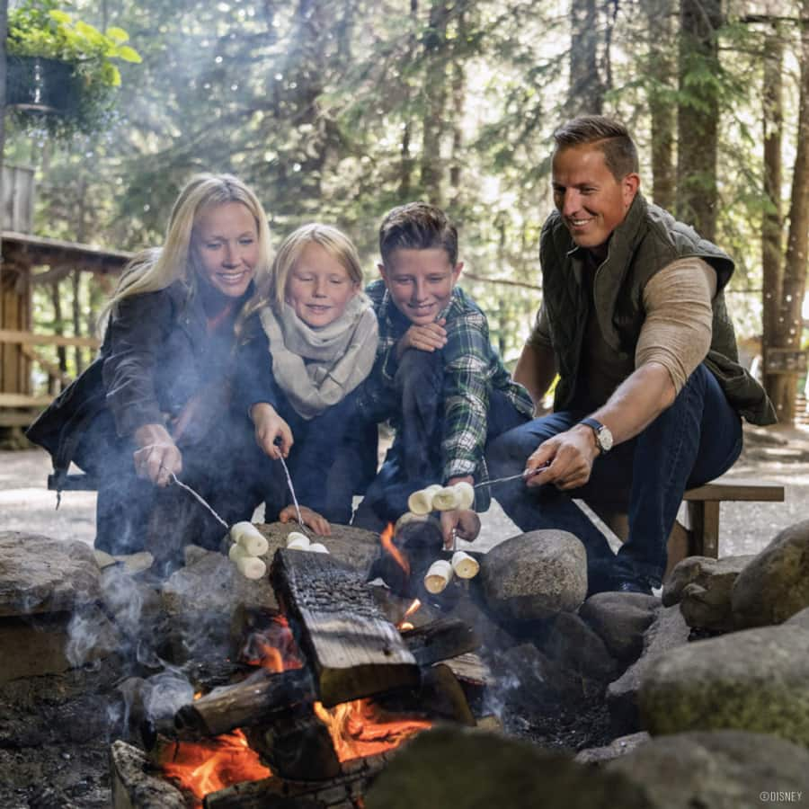 Family making S'mores on an Adventures by Disney Alaska trip