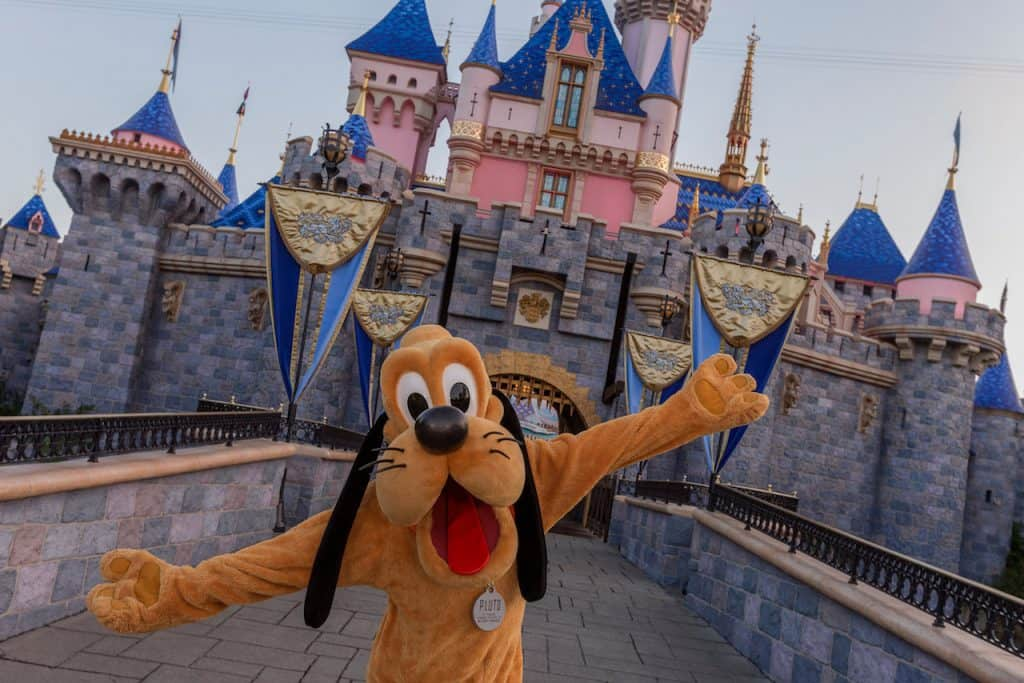 Pluto in front of Sleeping Beauty Castle at Disneyland Resort