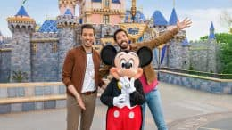 Drew and Jonathan Scott pose with Mickey Mouse at Disneyland Park