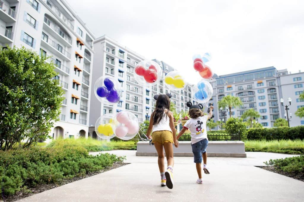 Kids with balloons at Disney's Riviera Resort