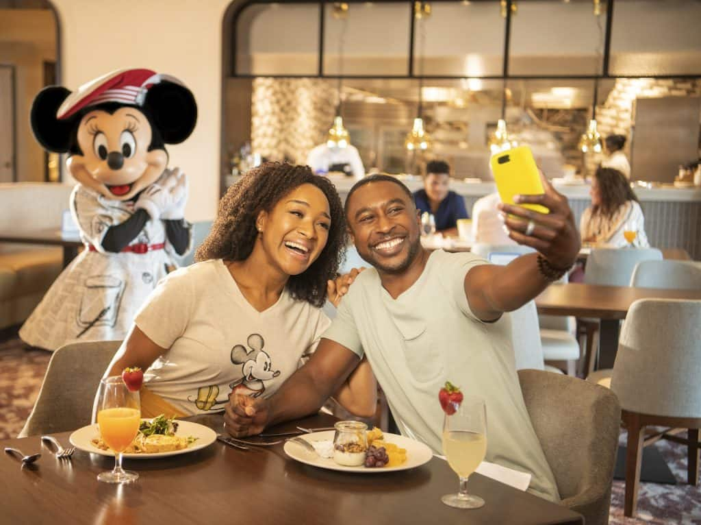 Couple eating breakfast at Disney's Riviera Resort