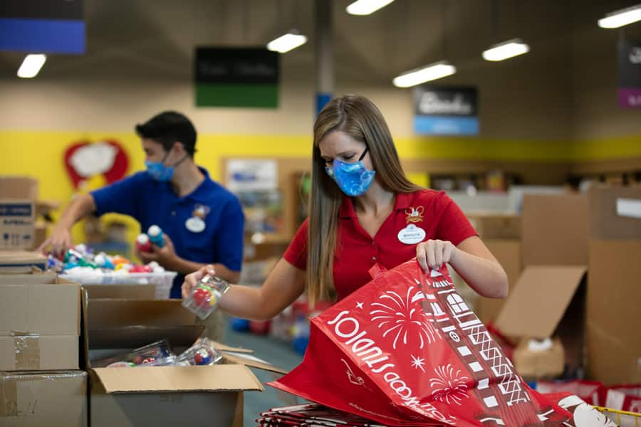 Walt Disney World Ambassadors Marilyn West and Stephen Lim packing supplies at A Gift For Teaching