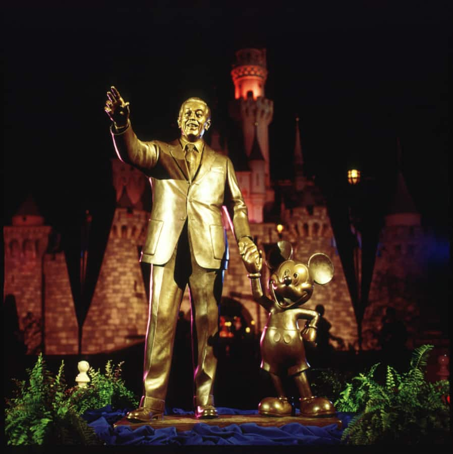 Photo of the Partners statue taken at its original unveiling on Nov. 18, 1993, at the hub in Disneyland park to commemorate Mickey's 65th birthday.