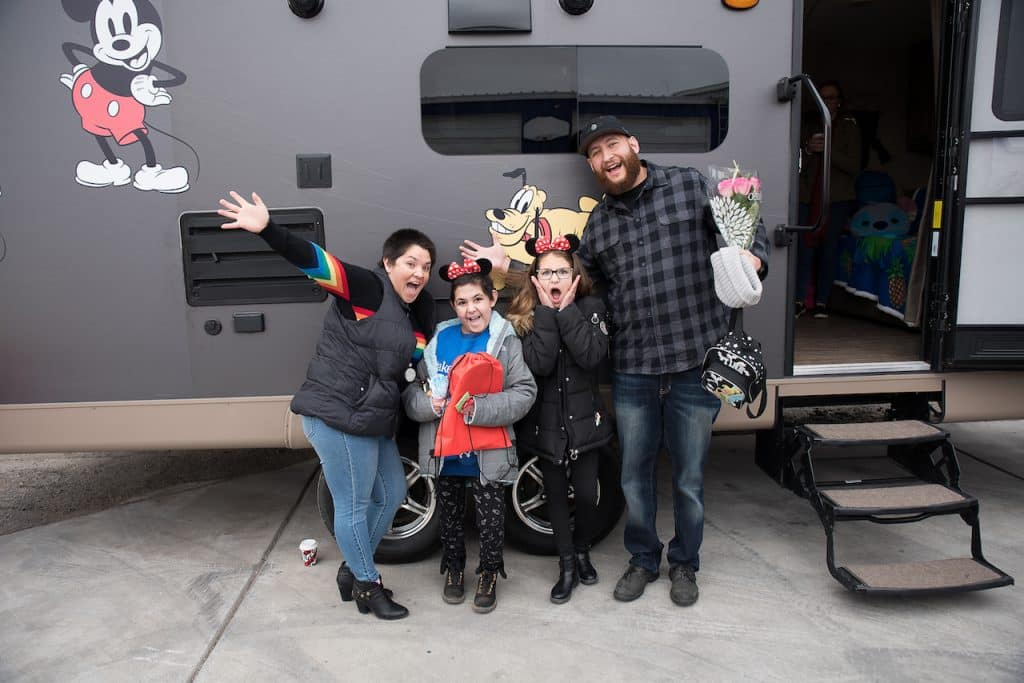 Wish kid Tali and her family in front of her Disney-themed RV