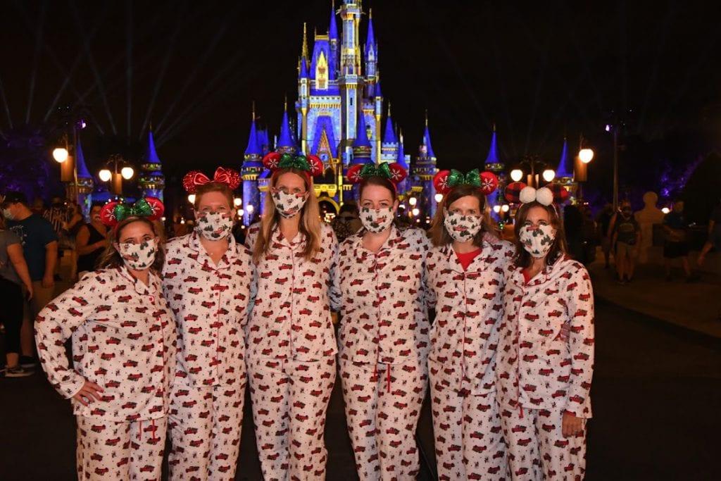 Guests in Christmas pajamas at Magic Kingdom Park
