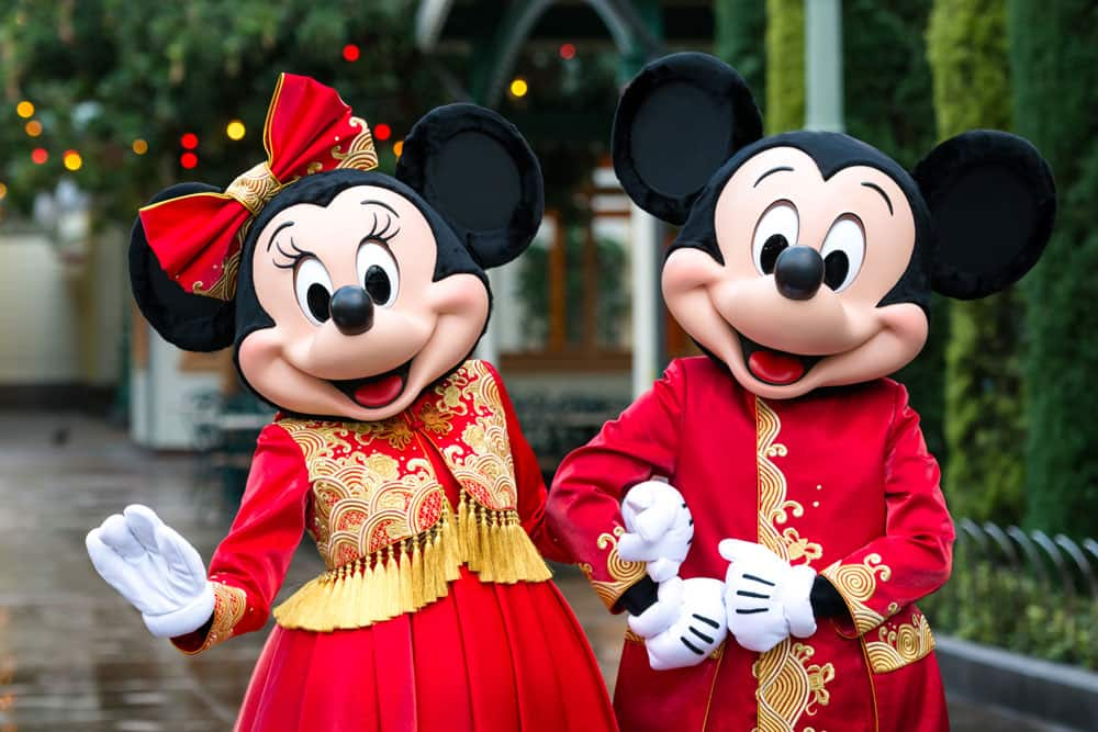 Mickey and Minnie wearing Lunar New Year-inspired outfits