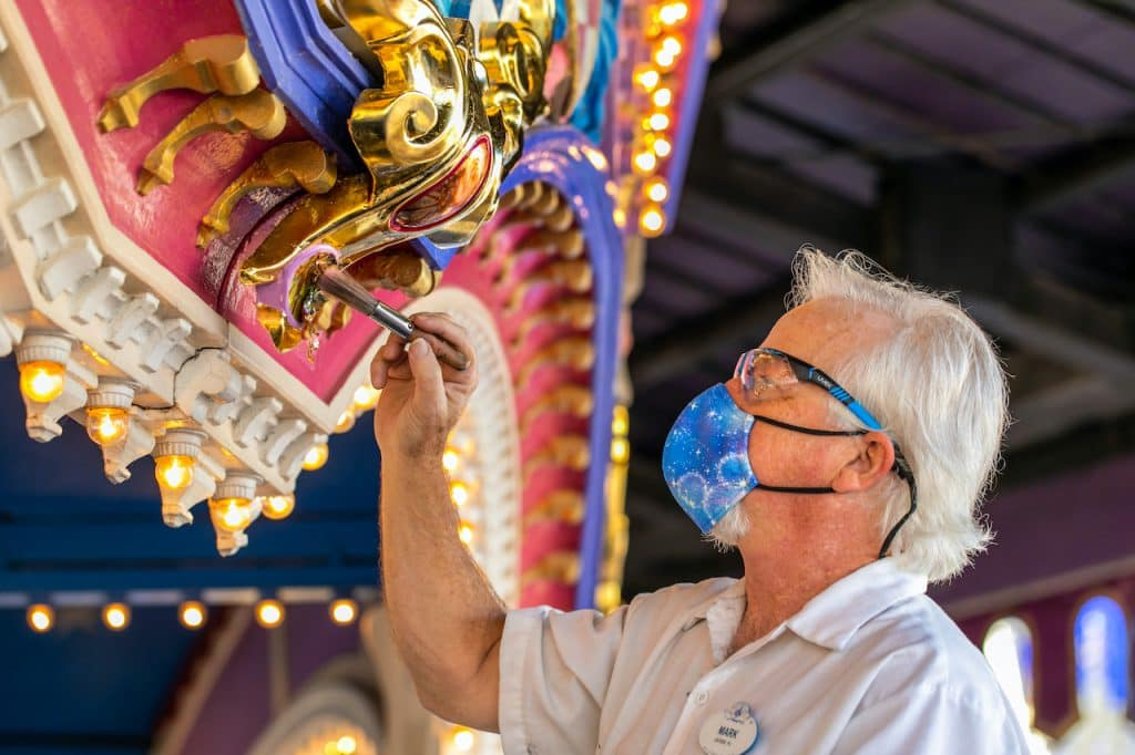 Cast member updating an attraction at Magic Kingdom Park