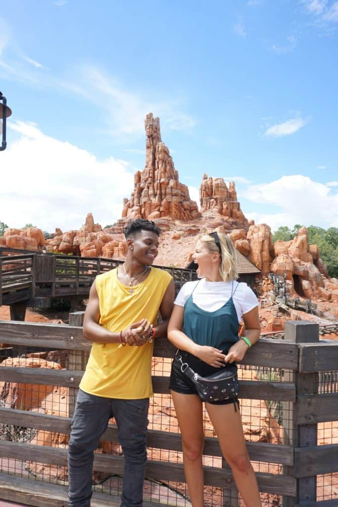 Marvel's 'Cloak and Dagger' stars Aubrey Joseph and Olivia Holt in front of Big Thunder Mountain Railroad at Magic Kingdom (July 2018)