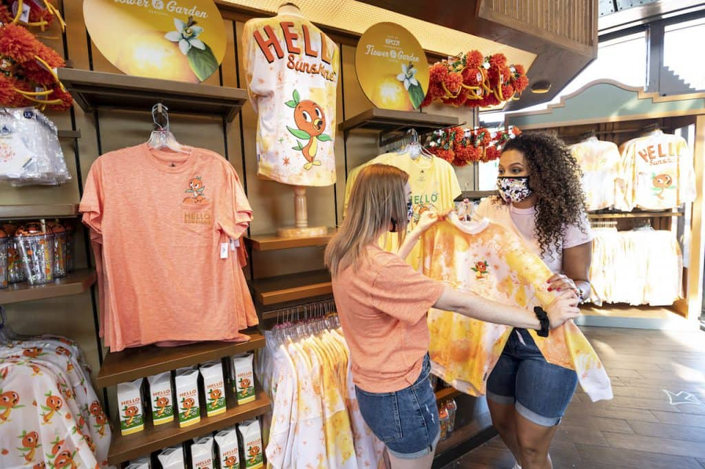 Guests looking at the Taste of EPCOT International Flower & Garden Festival merchandise
