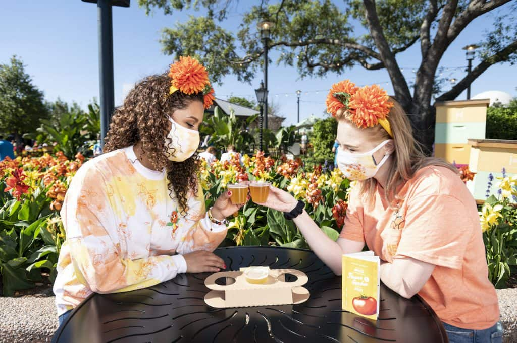 Guests trying the Pineapple Beer Flight at the Pineapple Promenade , part of the 2021 Taste of EPCOT International Flower & Garden Festival