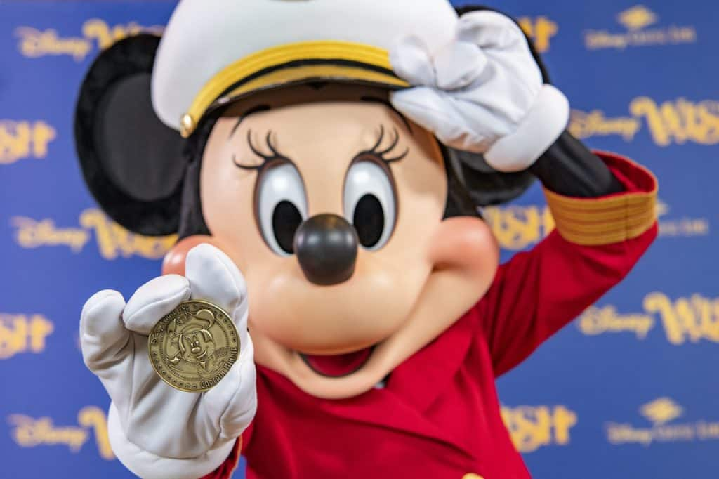 Minted coin featuring Captain Minnie Mouse that is placed under the keel of the new Disney Wish