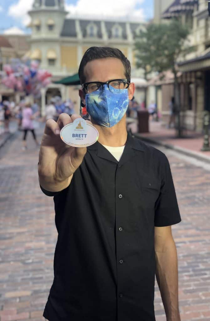 Brett Owens, a graphic designer with Disney Live Entertainment, with the Walt Disney World 50 Anniversary name tag