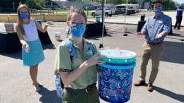 Cast member at Disney's Animal Kingdom showing her one-of-a-kind compost bucket