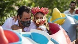 Family on Dumbo the Flying Elephant at Disneyland Park