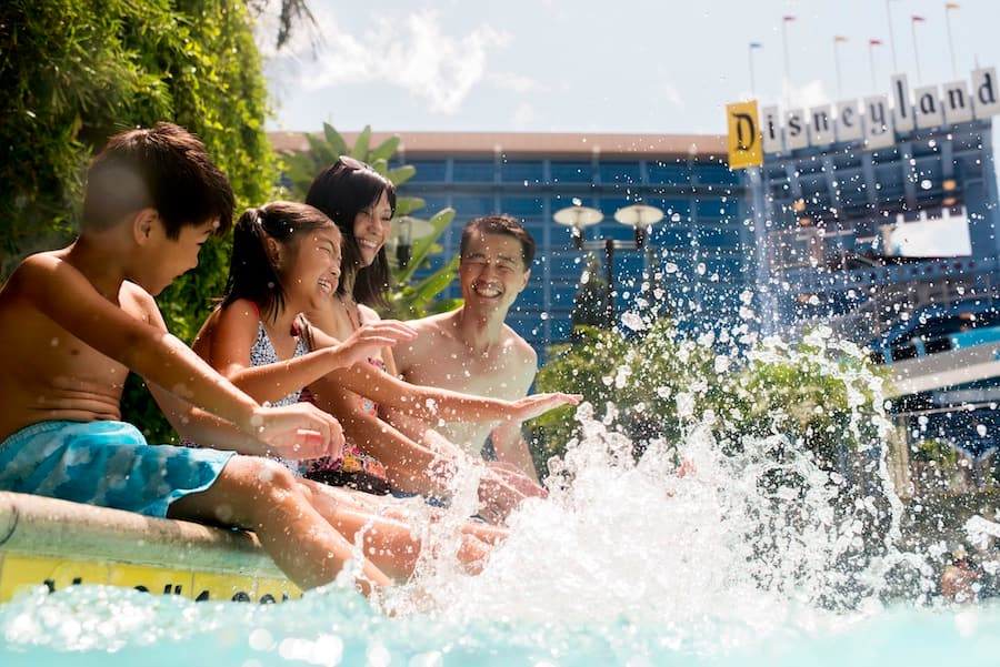 Family enjoying the pool at the Disneyland Hotel