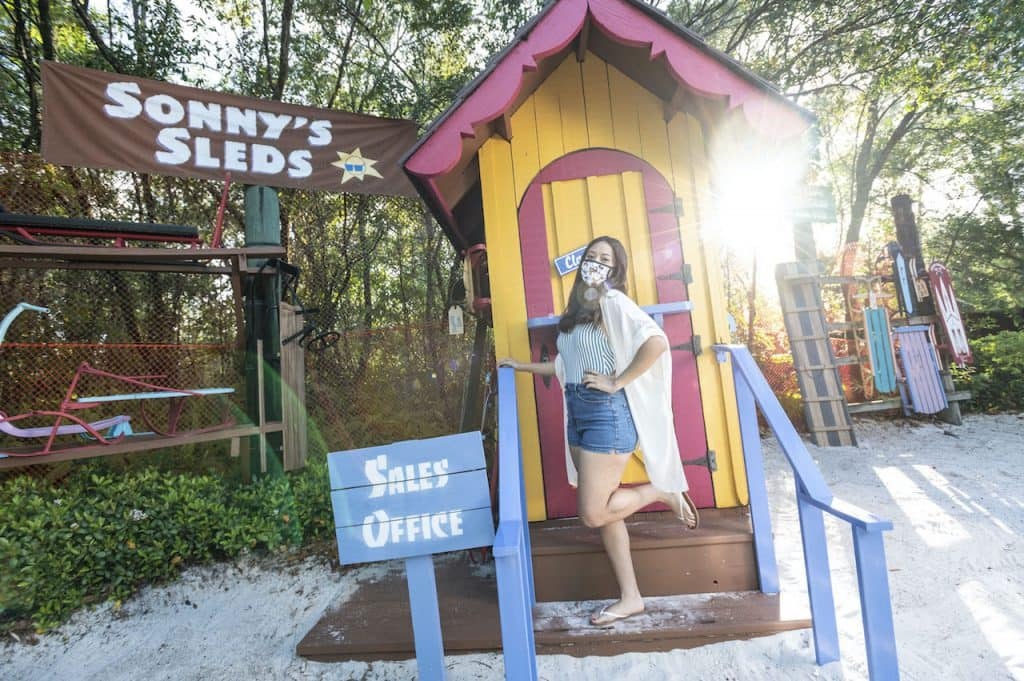A guest taking a picture at Sonny's Sleds at Disney's Blizzard Beach Water Park