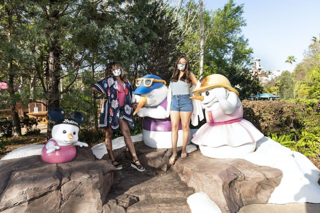 Guests taking a picture with the snowman family at Disney's Blizzard Beach Water Park