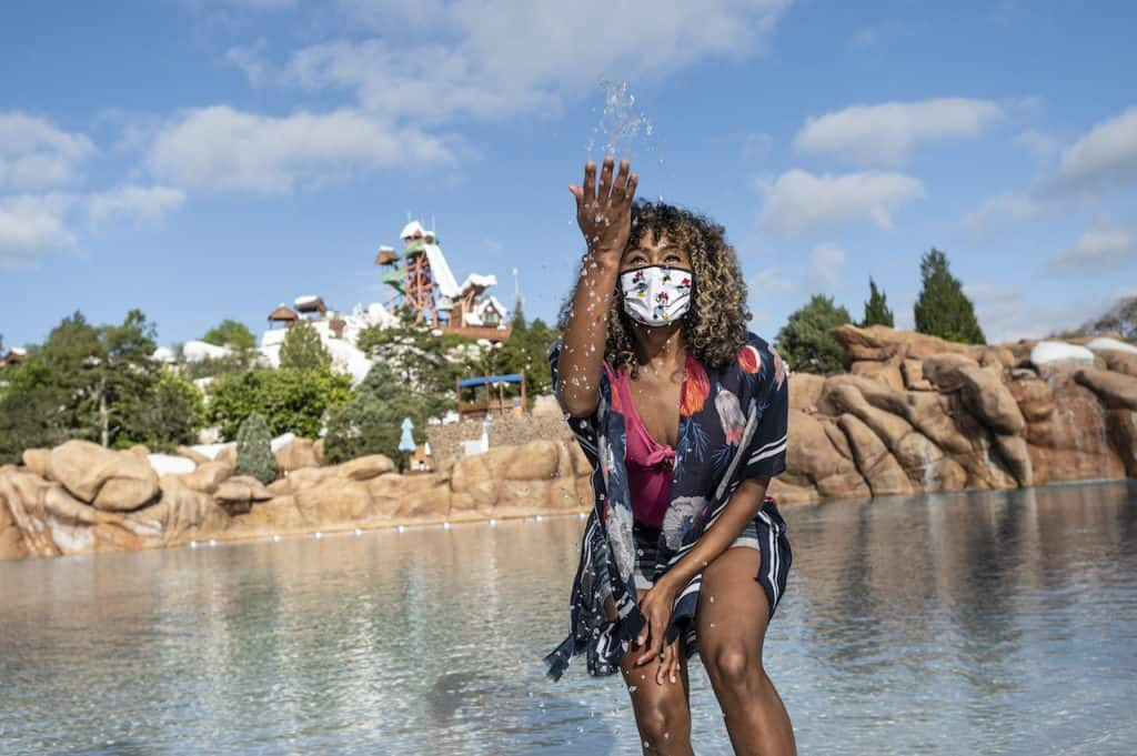 Guest taking a picture at Melt-Away Bay at Disney's Blizzard Beach Water Park