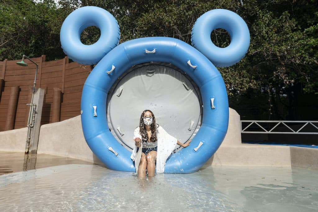 Guest taking a picture at the Hidden Mickey Raft at Disney's Blizzard Beach Water Park