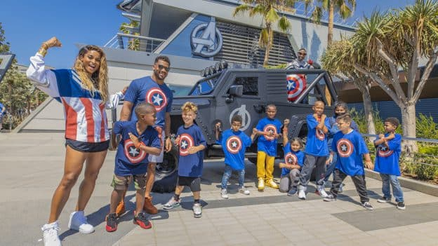 Seattle Seahawks quarterback Russell Wilson with a group of Los Angeles-based kids at Avengers Campus