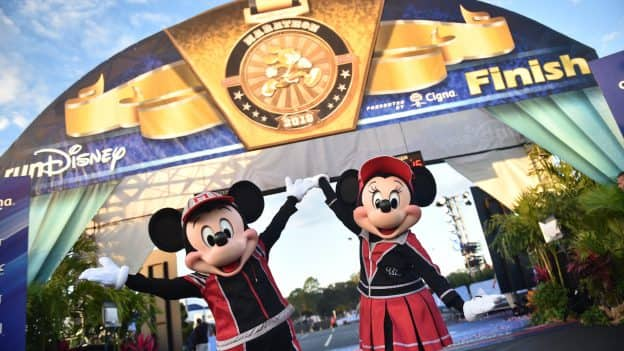 Mickey Mouse and Minnie Mouse at the end of a runDisney race
