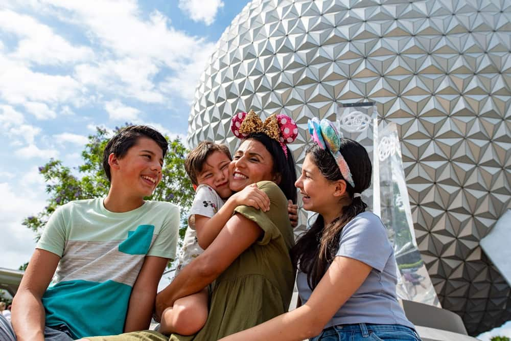 Family sitting in front of spaceship at EPCOT