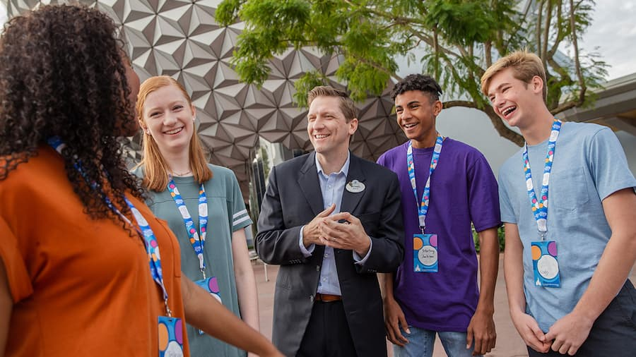 Students talking with a Disney leader at EPCOT