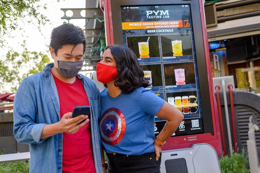 Couple using Mobile Order at Avengers Campus at Disney California Adventure park