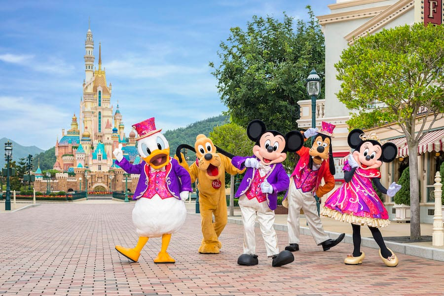 Mickey Mouse and friends in front of Castle of Magical Dreams in Hong Kong Disneyland