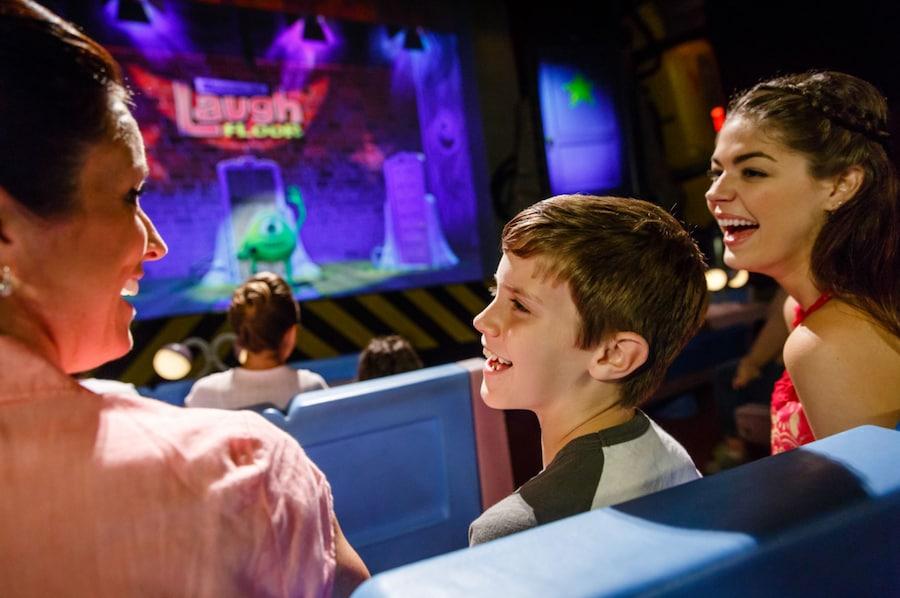 Family enjoying Monsters, Inc. Laugh Floor at Magic Kingdom Park