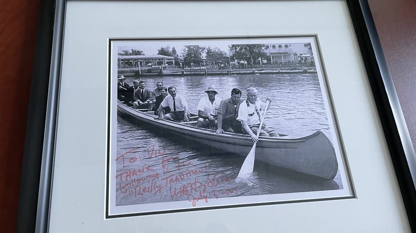 Black and white photo of Vin Reilly's grandfather paddling a canoe on the Rivers of America with passengers Walt Disney and Joe Fowler