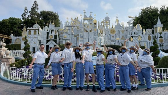 """Disneyland Resort cast members in front of """"it's a small world"""""""