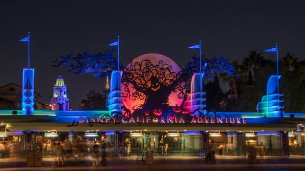Disney California Adventure park gates at night during Oogie Boogie Bash – A Disney Halloween Party