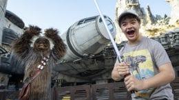 Gaten Matarazzo and Chewbacca at Star Wars: Galaxy's Edge at Disney's Hollywood Studios
