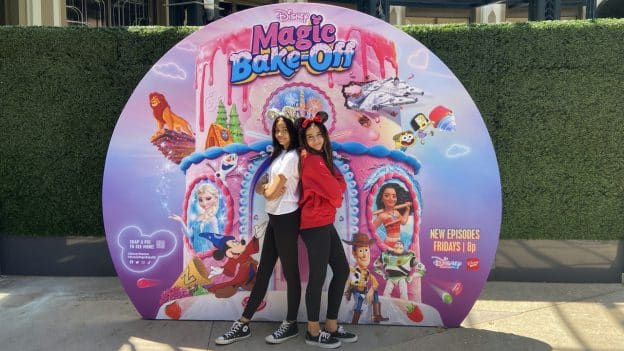 Girls at the 'Disney's Magic Bake-Off' photo opportunity at Downtown Disney District at Disneyland Resort
