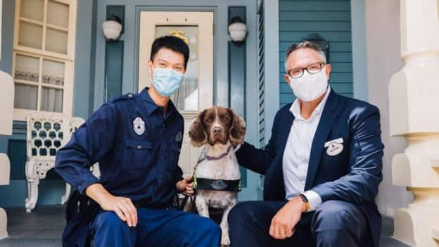 Trainer James with security dog Happy and Hong Kong Disneyland President Michael