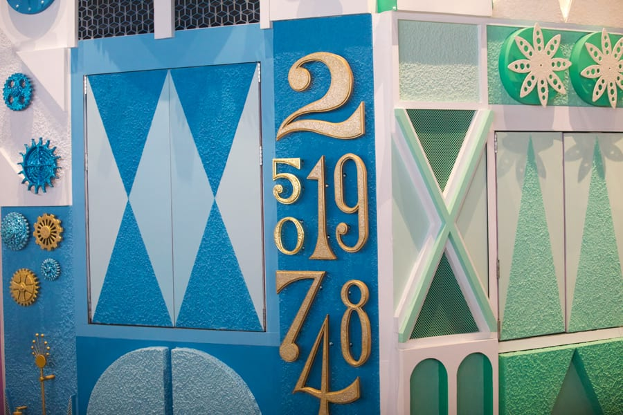 """Gold leaf detail of the """"5"""" and """"0"""" on the """"it's a small world"""" clock tower at Magic Kingdom Park"""