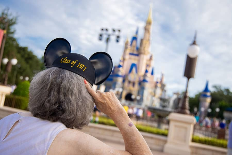 A cast member shows off their new Class of 1971 Mickey ears.