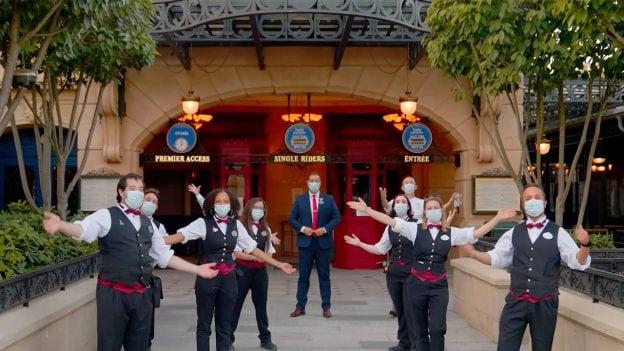 Disneyland Paris cast members waving