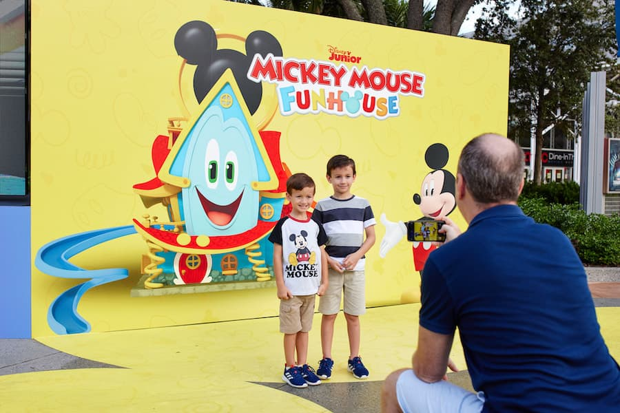 """Kids in front of a """"""""Mickey Mouse Funhouse"""" Limited Time Pop-Up at Disney Springs"""