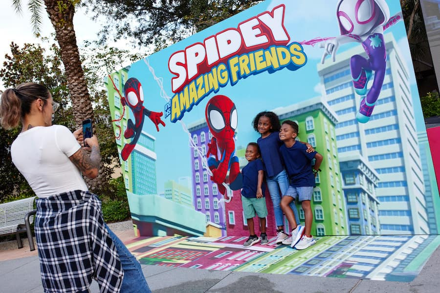 """Kids in front of a """"Spidey and his Amazing Friends"""" Limited Time Pop-Up at Disney Springs"""