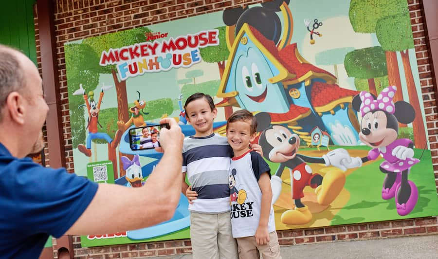 """Kids in front of a """"Mickey Mouse Funhouse"""" Limited Time Pop-Up at Disney Springs"""