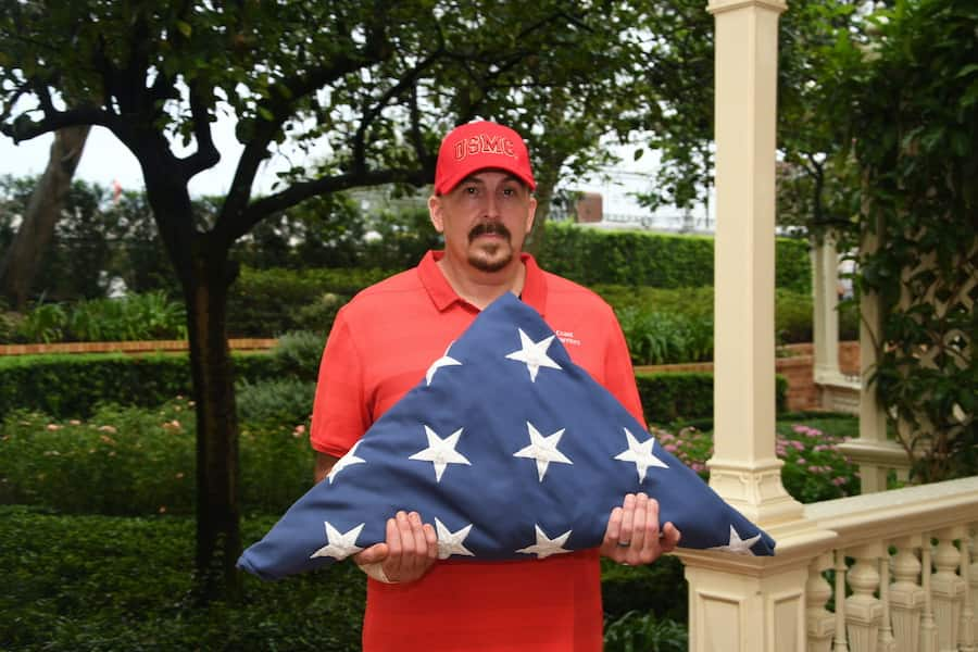 Rob Vickers of Gulf Breeze, Florida, with the flag at Magic Kingdom Park