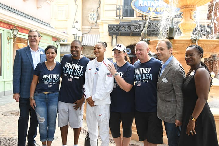 Kaylin with her family and Walt Disney World Executives