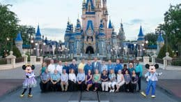 Members of the Walt Disney World 'Class of 1971' with Mickey and Minnie Mouse at Magic Kingdom Park.