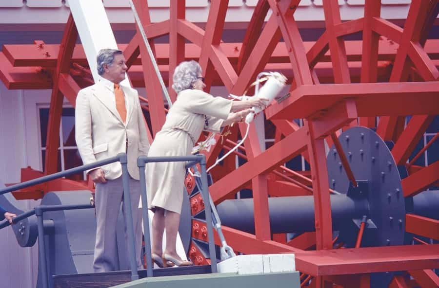 Lilly christens the boat with Donn Tatum, then chairman of the board, Walt Disney Productions