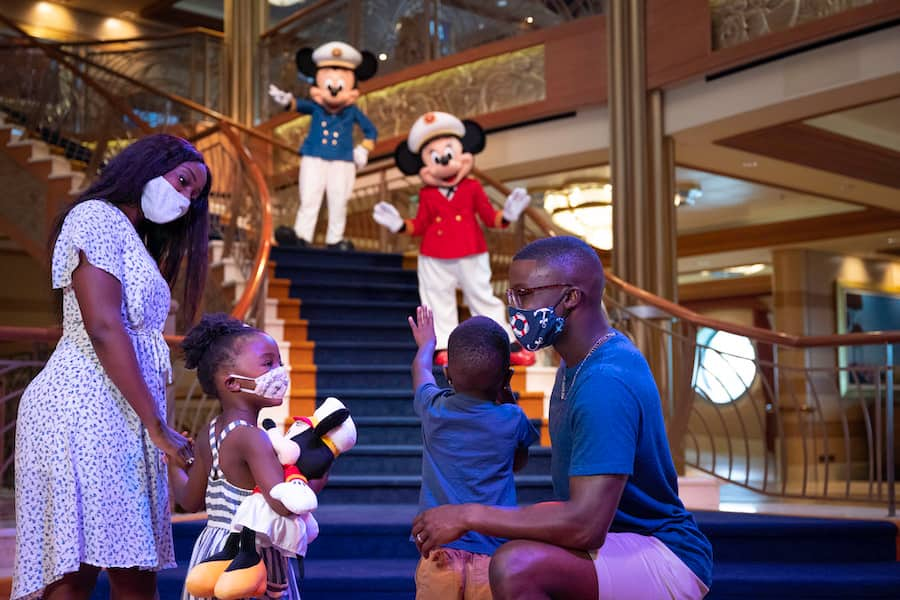 Family visiting characters on a Disney Cruise ship