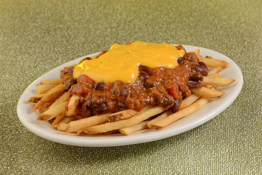 Cheese Fries with Walt's Chili – Crispy fries topped with Walt's favorite chili and cheddar sauce