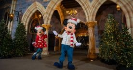 Mickey and Minnie in new holiday outfits